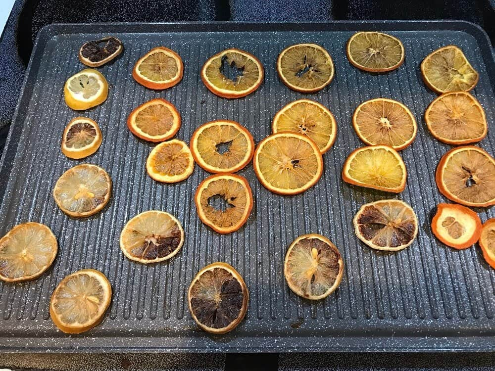 Dried citrus slices on grilling sheet for dried orange garland